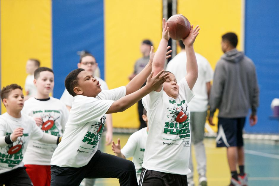 DJ Henderson 10 of Meriden jumps to catch a pass Saturday during the United Way NFL weekend kids camp at Choate Rosemary Hall in Wallingford March 10, 2018 | Justin Weekes / Special to the Record-Journal