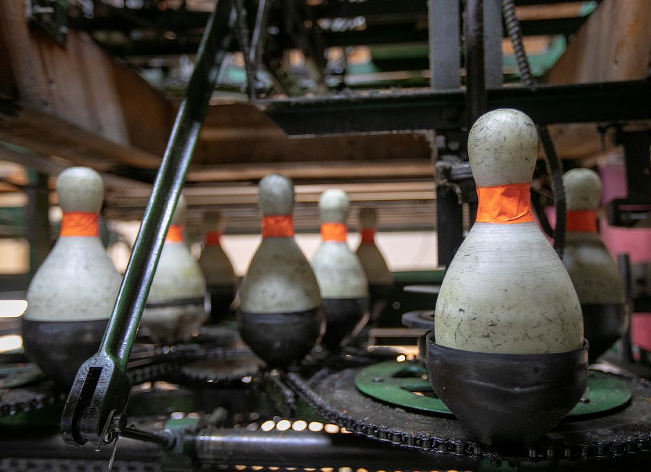 Duckpins cycle through a pinsetter behind the alleys at Highland Bowl, 1211 Highland Ave., Cheshire, Fri., May 3, 2019. Highland Bowl is a 20 lane family owned duckpin bowling center. Dave Zajac, Record-Journal