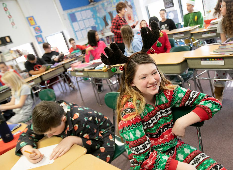 Seventh-grade student Makenna Fitzgerald, 12, wears her reindeer pajamas and antlers during PJ Day for the Kids at Our Lady of Mount Carmel Elementary School in Meriden, Fri., Dec. 14, 2018. Students and staff participated in PJ Day for the Kids in support of patients at Connecticut Children's Medical Center. The one dollar donation per person is to honor children at the hospital who wear their PJs for days, weeks or longer while fighting cancer or other serious illnesses. Dave Zajac, Record-Journal
