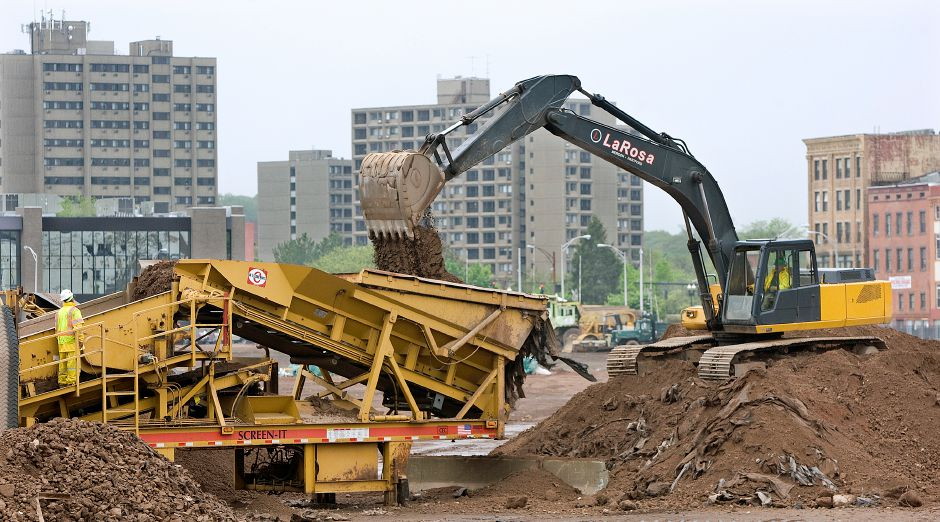 The operator of an excavator drops soil into a screener as crews from LaRosa Construction continue work at the Hub site in downtown Meriden, Friday, May 16, 2014. | Dave Zajac / Record-Journal