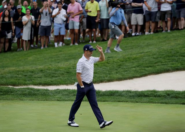 Justin Thomas celebrates an eagle on the 16th hole during the third round of the BMW Championship golf tournament at Medinah Country Club, Saturday, Aug. 17, 2019, in Medinah, Ill. (AP Photo/Nam Y. Huh)