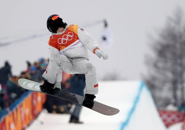 Shaun White, of the United States, jumps during the men