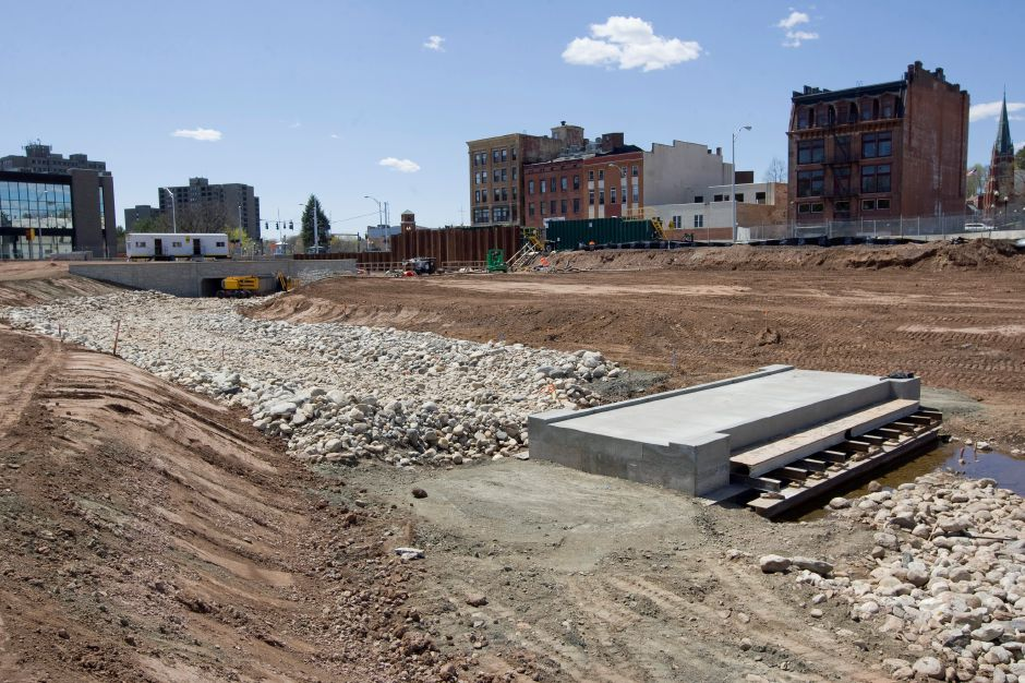 A finished concrete footbridge is seen on the 14-acre Meriden Hub as construction continues there, Wednesday, April 29, 2015. | Dave Zajac / Record-Journal
