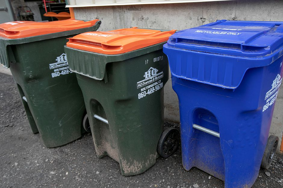 Trash and recycling containers at HQ Dumpsters & Recycling.