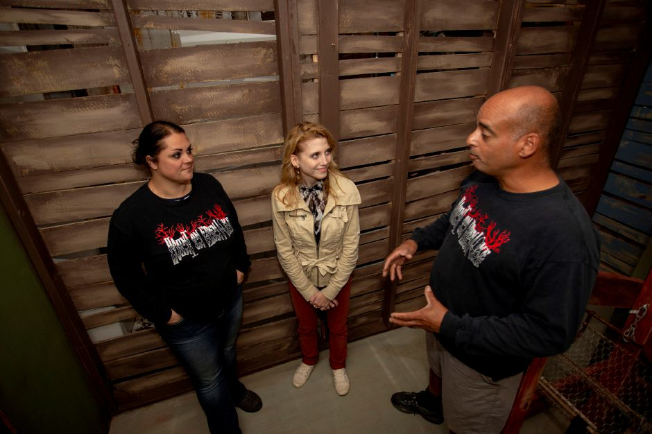 Record-Journal Digital Content Producer Ashley Kus, center, talks with Haunt on Eden founders Susan and Jeff Donis Oct. 3, 2018. | Richie Rathsack, Record-Journal