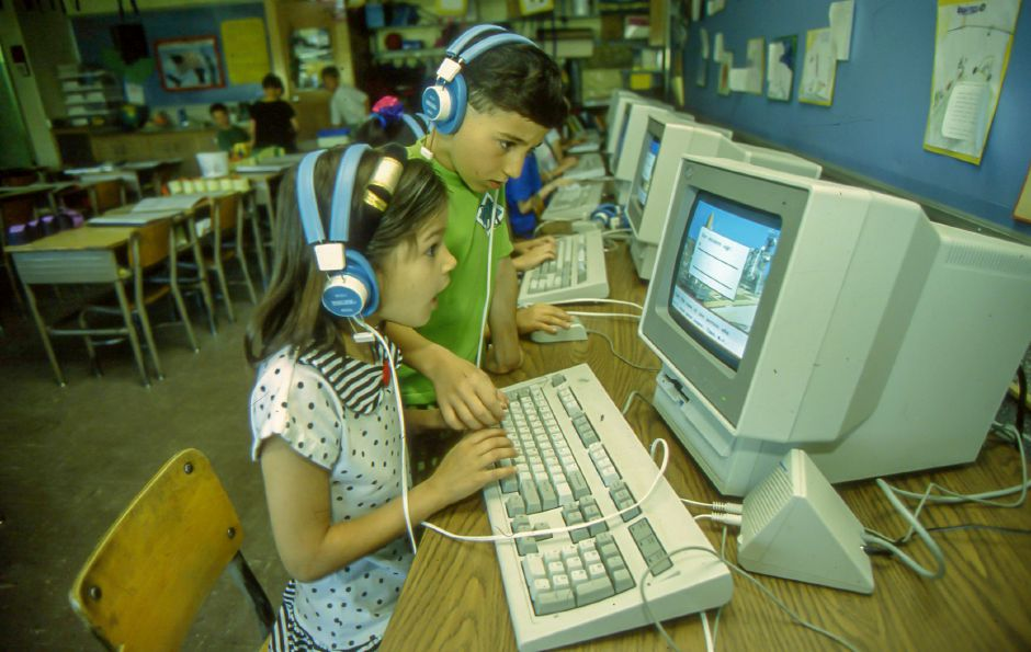 RJ file photo - North Center School second-graders Lacey Escabales and Andrew Fiondella, students of Nancy Haney, use a computer in class May 7, 1993.