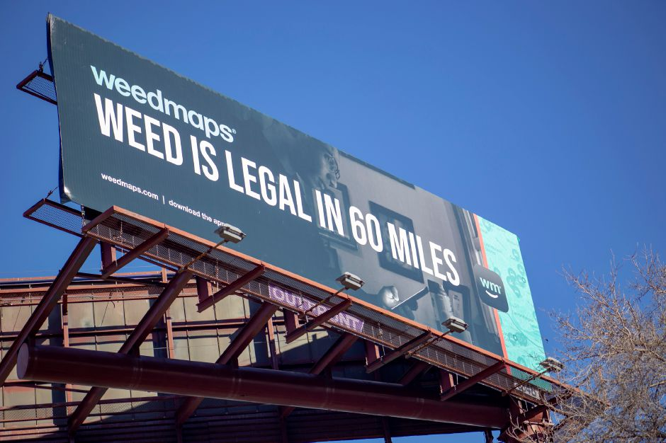 A billboard along Grand Avenue in New Haven informs motorists on Interstate 91 north that marijuana is legal in 60 miles, the distance to the Massachusetts border, Feb. 9, 2019. | Richie Rathsack, Record-Journal
