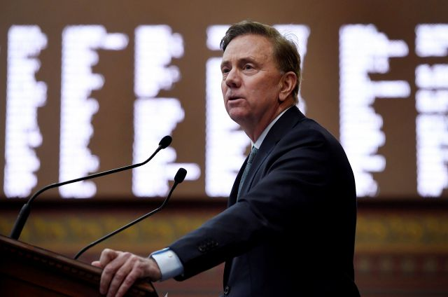 In this Wednesday, Feb. 20, 2019 photo, Connecticut Gov. Ned Lamont delivers his budget address at the State Capitol in Hartford, Conn. The Democrat
