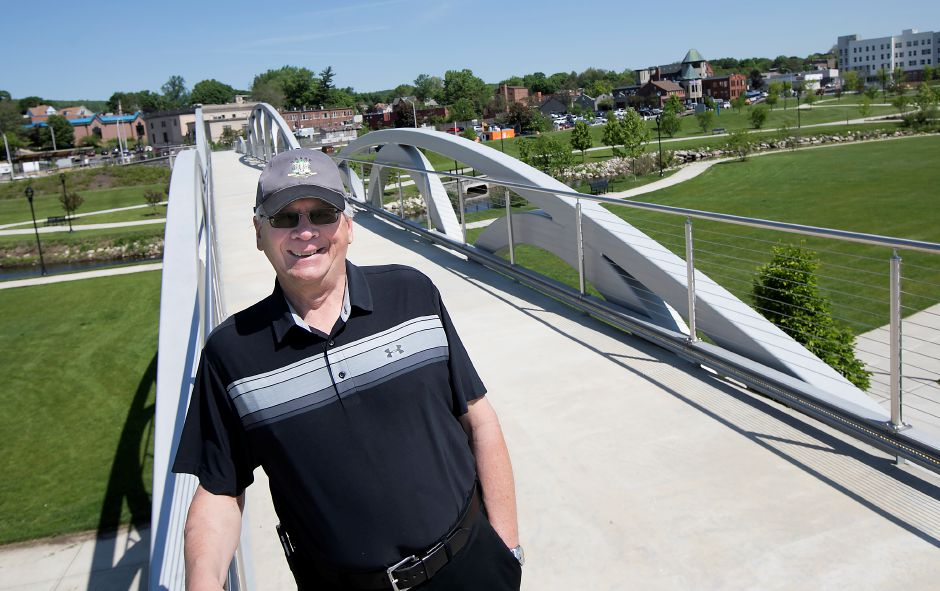 Public Works Director Bob Bass stands on the pedestrian bridge overlooking the Meriden Green, Thursday, May 24, 2018. Bass is retiring in September after 15 years of service. Dave Zajac, Record-Journal