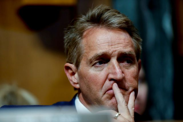 Sen. Jeff Flake, R-Ariz., attends a Senate Judiciary Committee meeting, Friday, Sept. 28, 2018 on Capitol Hill in Washington (AP Photo/Pablo Martinez Monsivais)