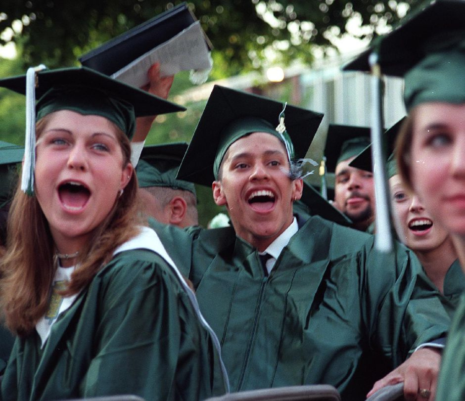 RJ file photo - Rebecca Joan Olmstead (L) and Neftali Ortiz cheer on their classmates recieving diplomas at Maloney High School