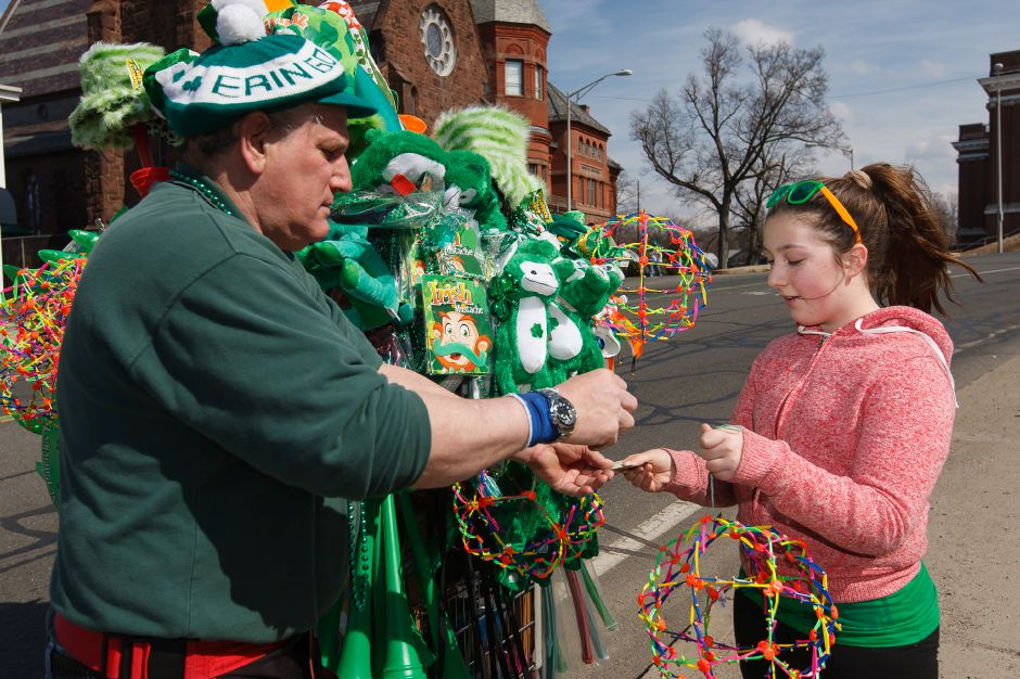 Lea Cioffi 11 of Wallingford buys a toy from Jeff Green of Uncasville during the St. Patrick