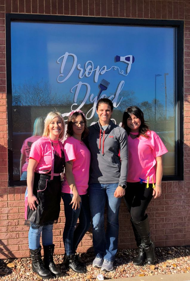 From left, Lauren Zup, owner of Drop Dyed Gorgeous hair salon in Berlin, Rosalee Frank, Berlin Police Officer Aimee Kryzkowski and Sarah Sagnella. The salon held a fundraiser for Kryzkowski's cancer treatment on Nov. 4, 2018 raising over $1,500. | Image courtesy of Lauren Zup