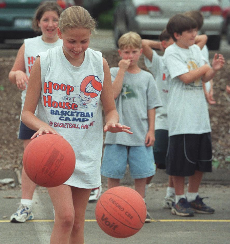 Brittany Folk, 11, of Wallingford, practices walking while dribbleing two basketballs at The Hoop House Basketball Camp at the Wallingford Park and Recreation Center July 1999.