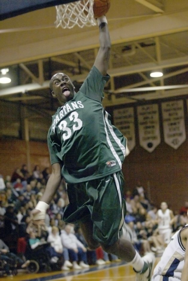 MERIDEN, Connecticut - Wednesday, February 20, 2008 - Maloney Spartans Shoquan Stevens throws down a dunk in the first half of a boys basketball game against cross town rival Platt on Wednesday, Feb. 20, 2008. Rob Beecher / Record-Journal