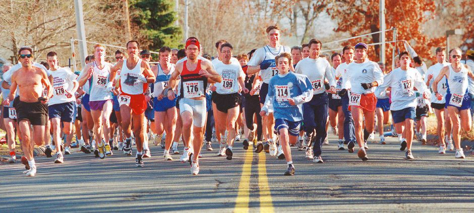 RJ file photo - The swift of foot start the Turkey Trot 5-mile road race on Wharton Brook Drive Nov. 22, 1998.
