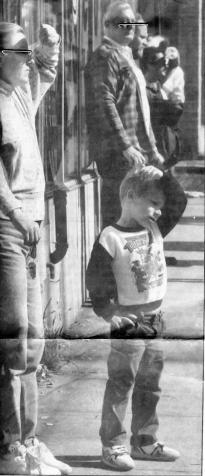 File photo - Robin Maddalena and her son, Joey, 5, watch as the Popular Restaurant demolition takes place in downtown Southington Oct. 22, 1991.