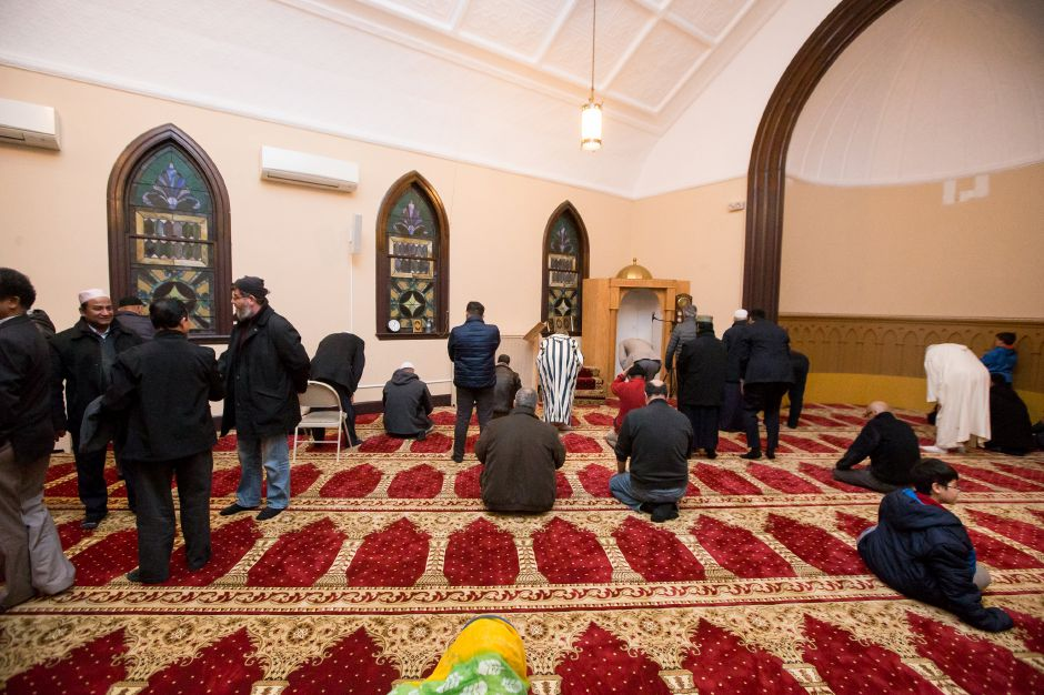 Members and guests in the prayer room  celebrate the opening.