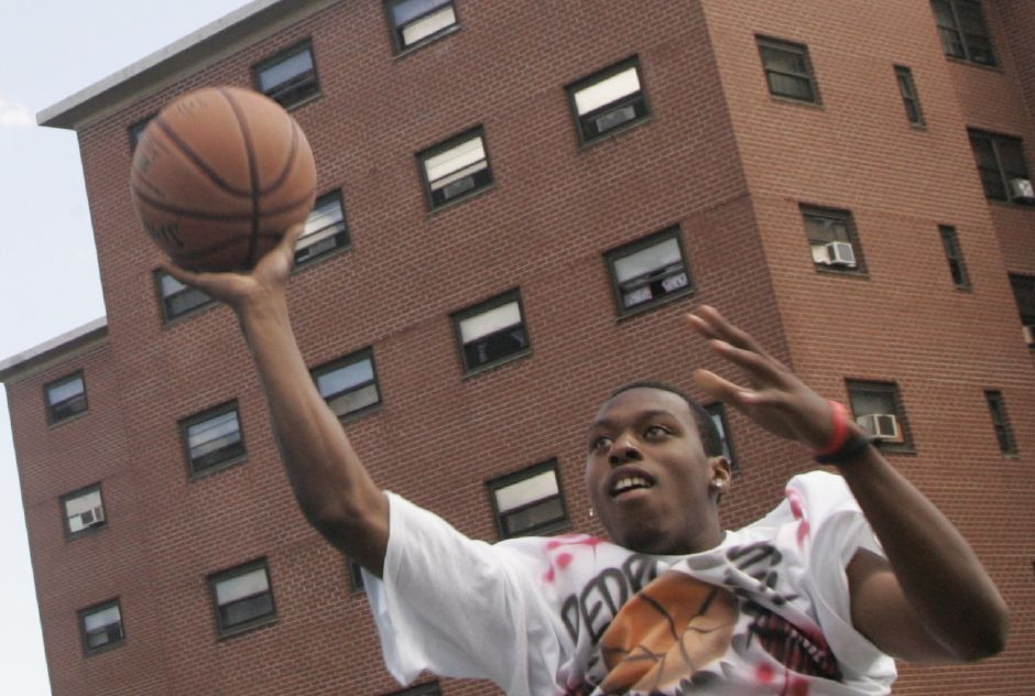 Malachi Bunch of Meriden takes a shot while competing in the 4th annual Pedro Valentin Basketball Tournament held at Mills Memorial on Cedar Street in Meriden Sunday July 1, 2007. The event was sponsored by Nationwide Insurance and Eblens. (dave zajac photo)