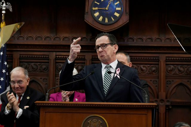 Connecticut Gov. Dannel P. Malloy gestures to his wife Cathy during opening session at the state Capitol, Wednesday, Feb. 7, 2018, in Hartford, Conn. (AP Photo/Jessica Hill)
