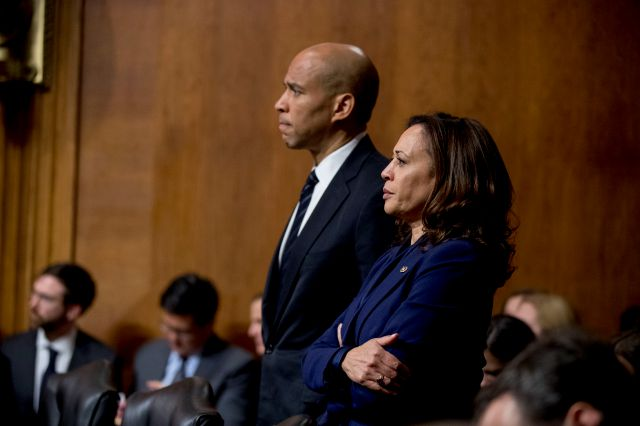 Sen. Cory Booker, D-N.J., and Sen. Kamala Harris, D-Calif., listen as Sen. Jeff Flake, R-Ariz., speaks during a Senate Judiciary Committee hearing on Supreme Court nominee Judge Brett Kavanaugh, Friday, Sept. 28, 2018, on Capitol Hill in Washington. The committee advanced Brett Kavanaugh
