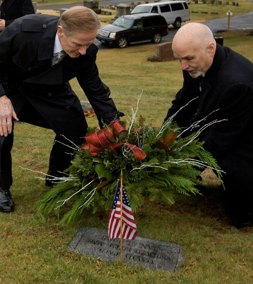 "Retired Police Chief Robert E. Kosienski, left, and Keith McCurdy, a Detective Sargent in 1988, lay a wreath at the grave of infant David Paul during an annual memorial service at Walnut Grove Cemetery in Meriden, Wednesday, January 4, 2017. The 1-day-old boy, was found frozen to death at the base of a tree in a South Meriden parking lot on Jan. 2, 1988. The police department adopted the child and gave him the name David Paul, which means ""God's beloved little man"" in scripture. The mother was never found and the case remains open. 