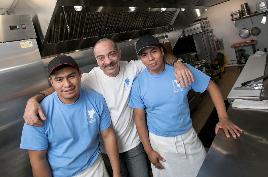 Left to right, owners Guadalupe Xelhua and Andreas Sophroniou with worker Antonio Xelhua at Crazy Greek restaurant at 1143 Meriden-Waterbury Tpke. in Southington, Thursday, February 23, 2017. | Dave Zajac, Record-Journal