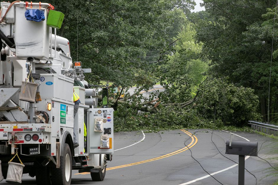 A large tree blocks the road on Meriden Avenue in Southington, Monday, July 23, 2018. More than 1,000 local Eversource Energy customers were without power after police said a tree fell and damaged utility poles and power lines near 905 Meriden Ave. Dave Zajac, Record-Journal