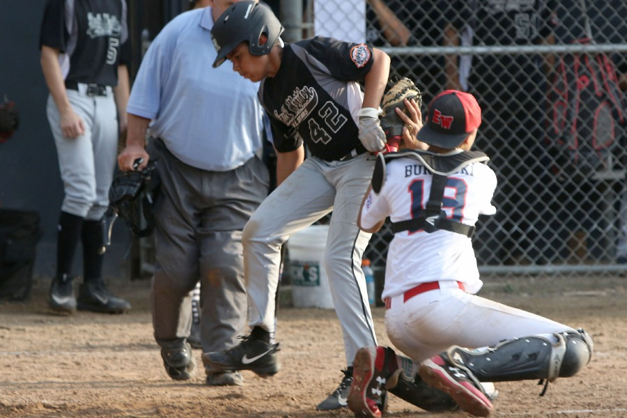 Ed Walsh catcher Zach Burdacki tags out South Meriden's Jayden Gather during Wednesday's Meriden City Series game at Habershon Field. Aaron Flaum, Record-Journal Staff