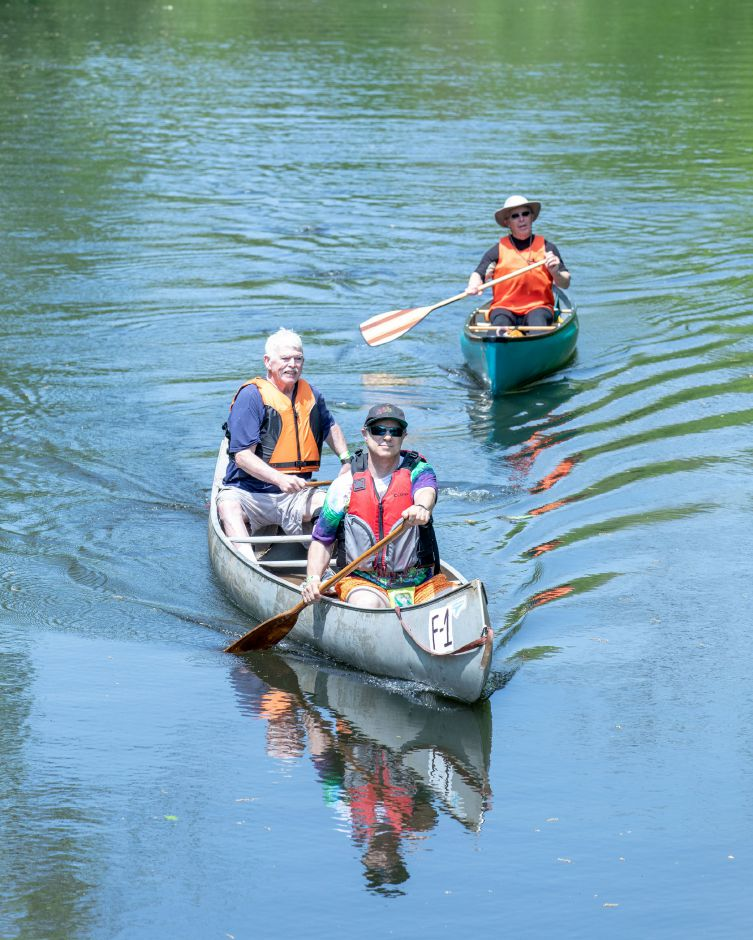 Rick Kaplan and Tom Long approach the finish line, trailed by TIm Louis in the Quinnipiac Downriver Classic race on May 19, 2019. The yearly kayak and canoe race attracted 35 participants this year, going from the Meriden-Waterbury Turnpike to the Red Bridge on Oregon Road in Meriden. Devin Leith-Yessian/Record-Journal