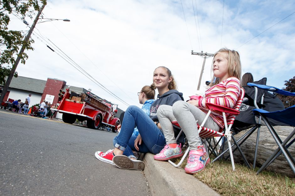 Madison Sicotte 14 and cousin Reagan Dumae 5 watch as the Southington Fire Department passes Sunday during the Southington Apple Harvest Festival Parade in Southington September 30, 2018 | Justin Weekes / Special to the Record-Journal