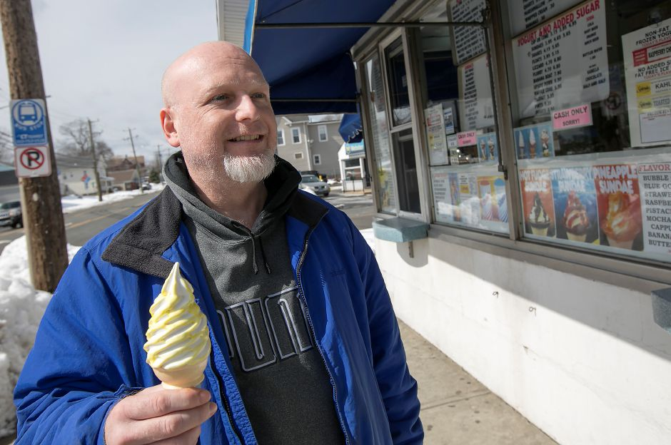 Tom Kenney, of Meriden, holds a Banana Burst ice cream cone during opening day of Les' Dairy Bar in Meriden, Wednesday, March 14, 2018. Dave Zajac, Record-Journal