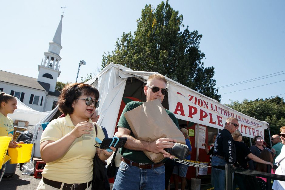 Scott and Marilynn Guerrera of Naugatuck pick up some apple fritters Saturday during the Southington Apple Harvest Festival in Southington September 29, 2018 | Justin Weekes / Special to the Record-Journal