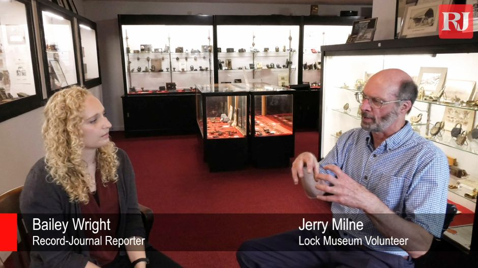 Lock Museum of America volunteer Jerry Milne talks with Record-Journal reporter Bailey Wright about the museum and escape room, on August 23, 2019. | Bailey Wright, Record-Journal