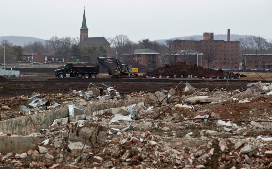 LaRosa Construction crews begin excavation work at the former Hub site in downtown Meriden, March 28, 2014. | Christopher Zajac / Record-Journal