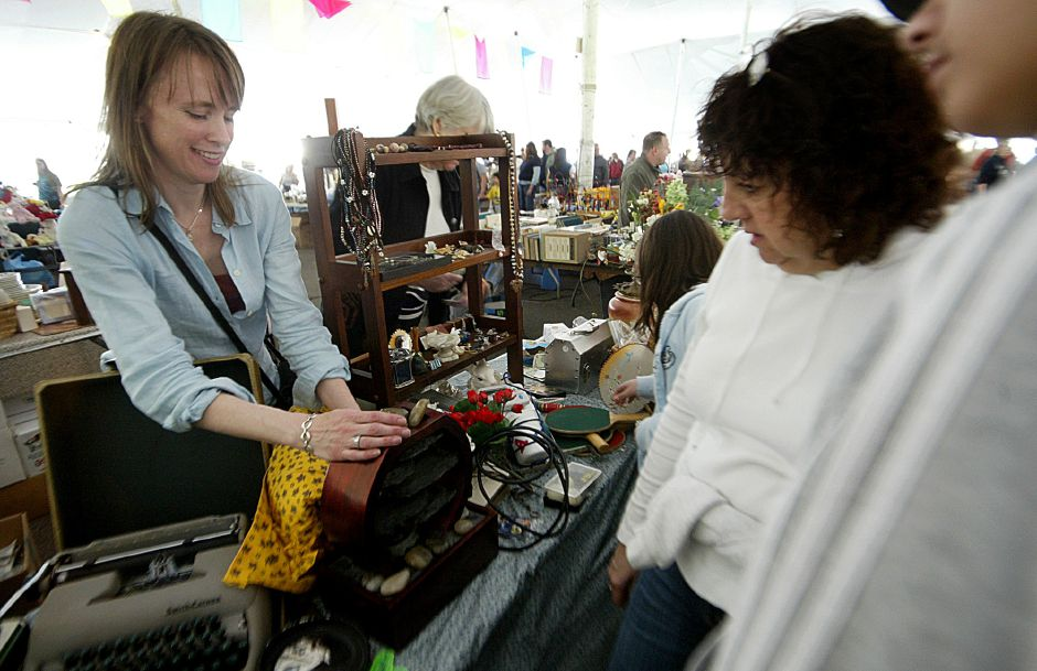 Record Journal Photo/ Johnathon Henninger 4.21.07 Polly Nugent of Branford shows Luci Clyne of Guilford a table-top waterfall at the Tag Sale at the Pre-Daffodil Festival on Mirror Lake in Meriden Saturday morning.
