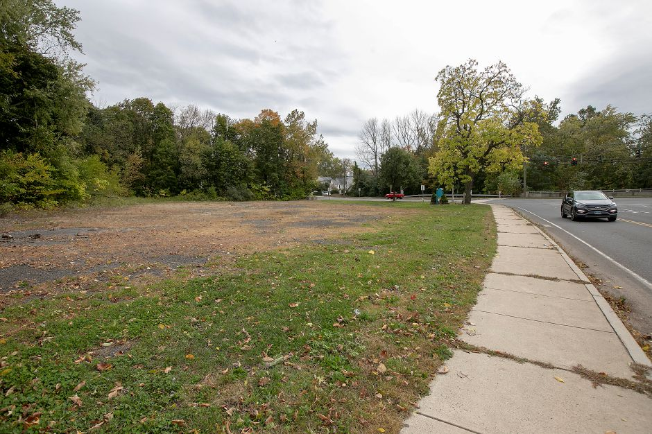 A motorist travels on West Street Friday, next to a vacant lot in Southington. Developers withdrew an application for a five-story hotel at  17 West St. Dave Zajac, Record-Journal
