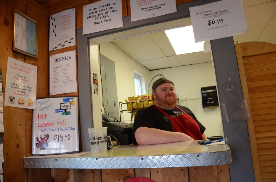 2 Guys One Grill's owner Michael Wambolt stands at the restaurant's cashier window on Tuesday.