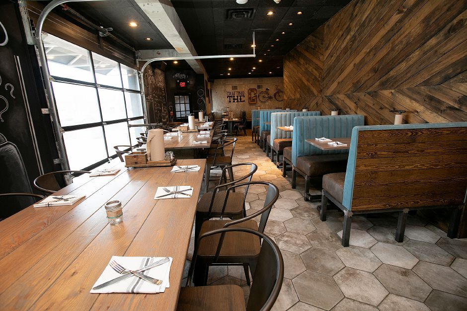 Dining room of Que Whiskey Kitchen, a barbecue restaurant and whiskey bar located at 461 Queen St, Southington, Wed., Mar. 13, 2019. Dave Zajac, Record-Journal