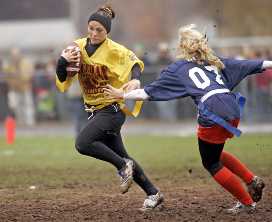 Sheehan running back Brooke Longyear, left, gets by the grasp of Lyman Hall defender Samantha Helm during the annual Lyman Hall/Sheehan Powder Puff game at Lyman Hall Wednesday November 21, 2007, (dave zajac photo)