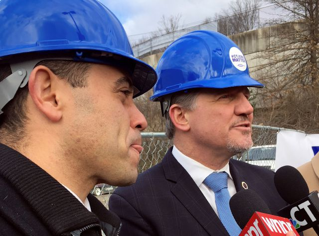 Rodney Butler, left, chairman of the Mashantucket Pequot Tribal Council, and Kevin Brown, right, chairman of the Mohegan Tribe, speak to the media Monday, March 5, 2018, during a ceremony in East Windsor, Conn., marking the start of demolition of a movie theater at the site of what they hope will be a new casino that the tribes would operate jointly. (AP Photo/Susan Haigh)