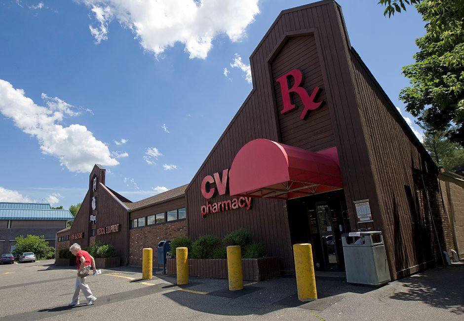 A customer walks out of CVS Pharmacy, formerly Kaye's Pharmacy at 679 E. Main St. in Meriden, Tuesday, June 7, 2016. The store is scheduled to close and move its operations to the new CVS now under construction on Broad Street. | Dave Zajac, Record-Journal