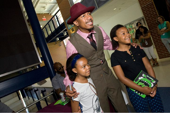 Nick Cannon, rapper, actor, comedian, producer, television and radio host, poses for a photo with Dayna Smith, 9, left, and sister, Danika, 11, of Meriden, at Lincoln Middle School in Meriden on June 24, 2015. Cannon was visiting Meriden to celebrate the students' success in reaching reading goals. Dayna is a student at Casimir Pulaski School and Danika is a student at Edison Middle School. | Dave Zajac | Record-Journal