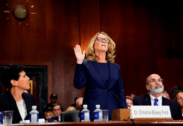 Christine Blasey Ford is sworn in to testify before the Senate Judiciary Committee on Capitol Hill in Washington, Thursday, Sept. 27, 2018. Her attorney