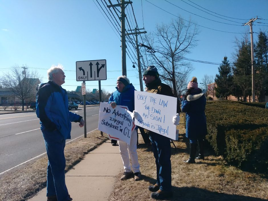 Members of the Coalition for a Better Wallingford stand outside on Washington Avenue to protest a billboard advertising the sale of marijuana in another state, in North Haven, Sat. Feb. 9, 2019. Jeniece Roman, Record-Journal