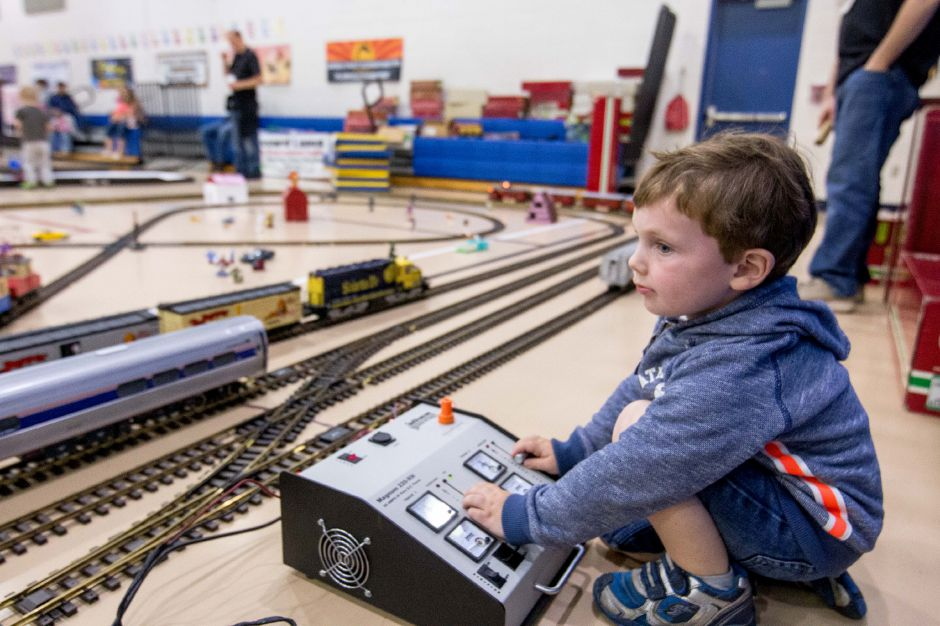 Andrew Kluz, 4, of Plainville, controls the model trains at the Plainville Family Fest on Saturday, May 20, 2018. The event featured facepainting, matchbox cars and dozens of vendors and organizations with tables throughout the halls of Linden Street School. | Devin Leith-Yessian/Plainville Citizen