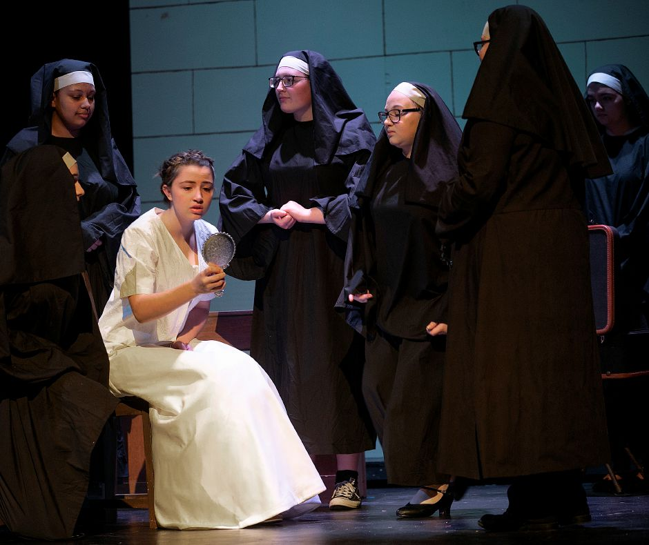 Angel Hart, 17, seated left, plays the role of Maria during rehearsel of The Sound of Music at Platt High School, Tues., Apr. 23, 2019.