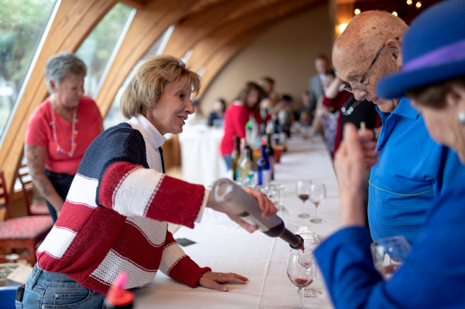 Beth Murphy pours wine during a wine tasting fundraiser for the Wallingford 350th Jubilee. Held at Gouveia Vineyard June 13, 2019, it attracted around 250 people to raise money for the town