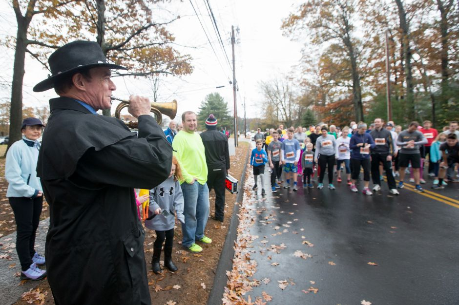 Mayor William Dickinson signals the start of the 5K race Sunday during the Kiwanis Club 5 mile and 5K Turkey Trot Road Race at Stevens Elementary School in Wallingford November 19, 2017 | Justin Weekes / For the Record-Journal