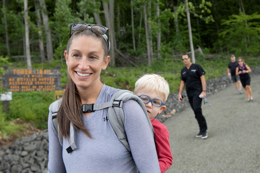 Laura Morris, of Hamden, carrying son Camden, 3, talks about hiking the Tower Trail.